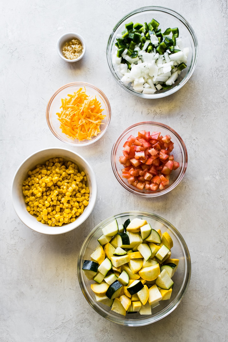 Ingredients to make calabacitas on a table.