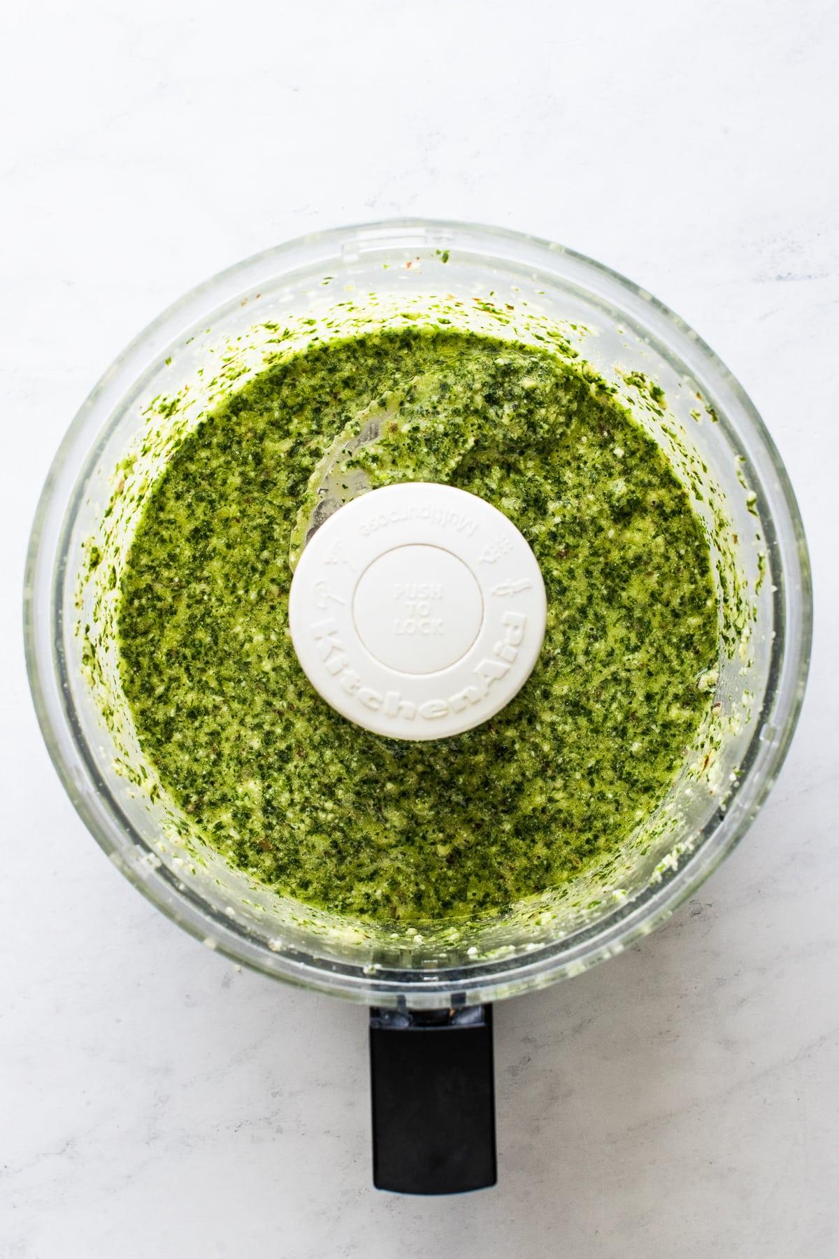 Cilantro pesto in a food processor already blended.