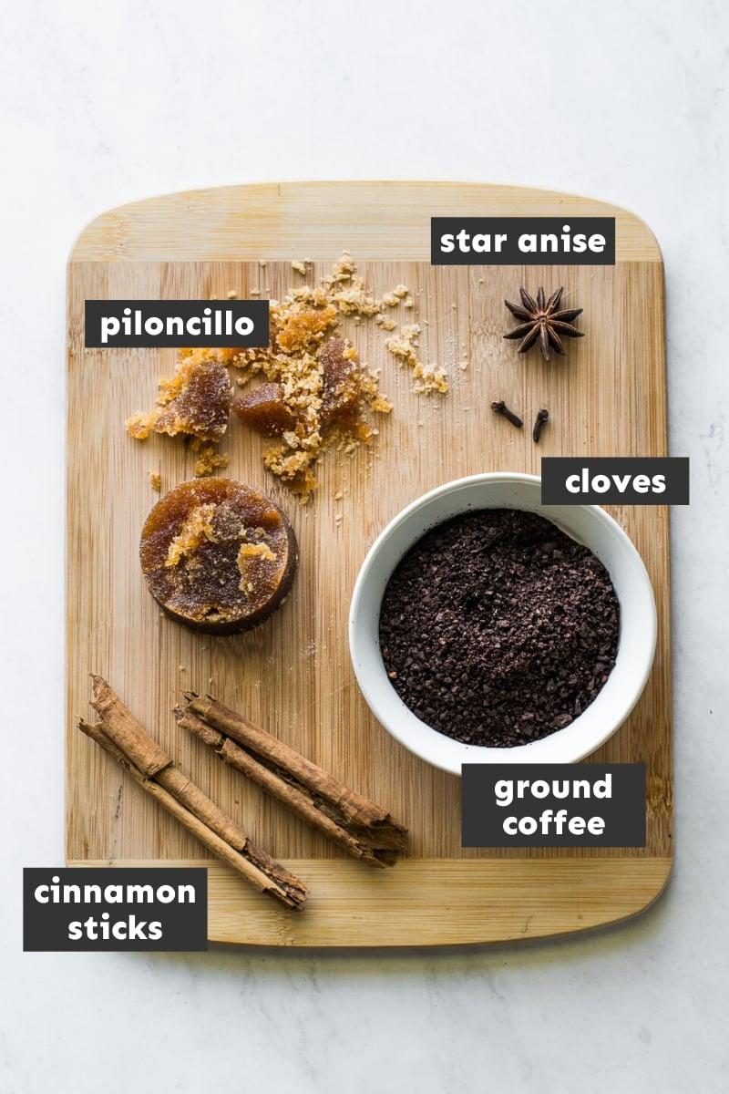 Cafe de olla ingredients on a cutting board.