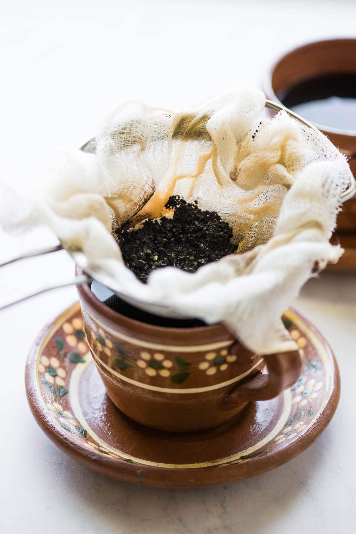 Coffee grounds being sifted from the cafe de olla.