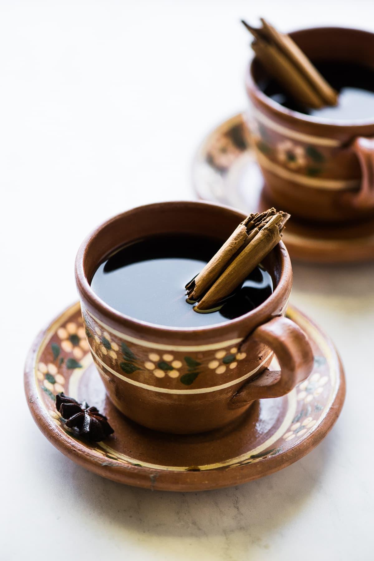 A mug full of cafe de olla or Mexican coffee