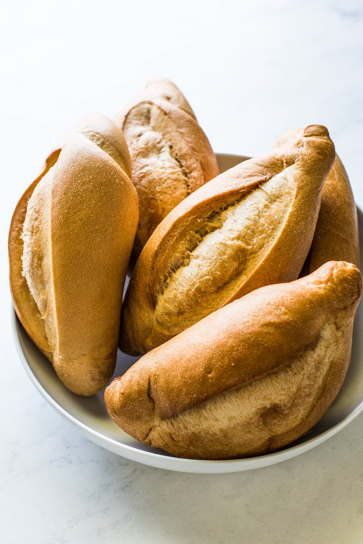 A basket full of bolillo bread.