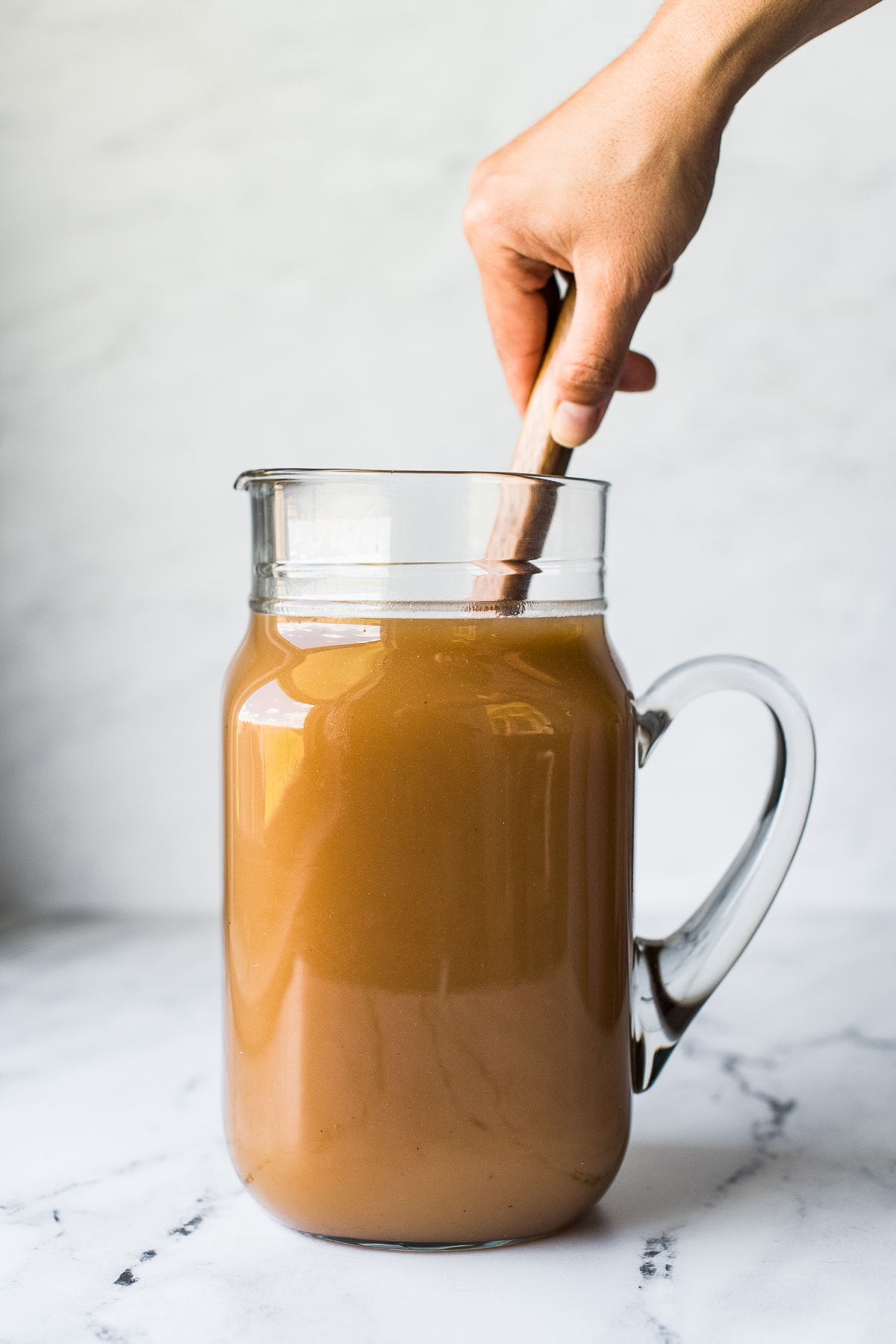 Mixing agua de tamarindo in a pitcher