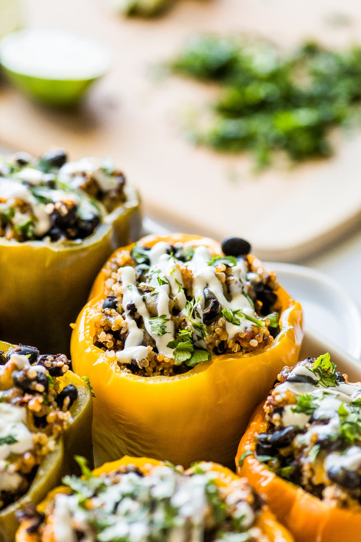 Stuffed peppers topped with sour cream and cilantro.
