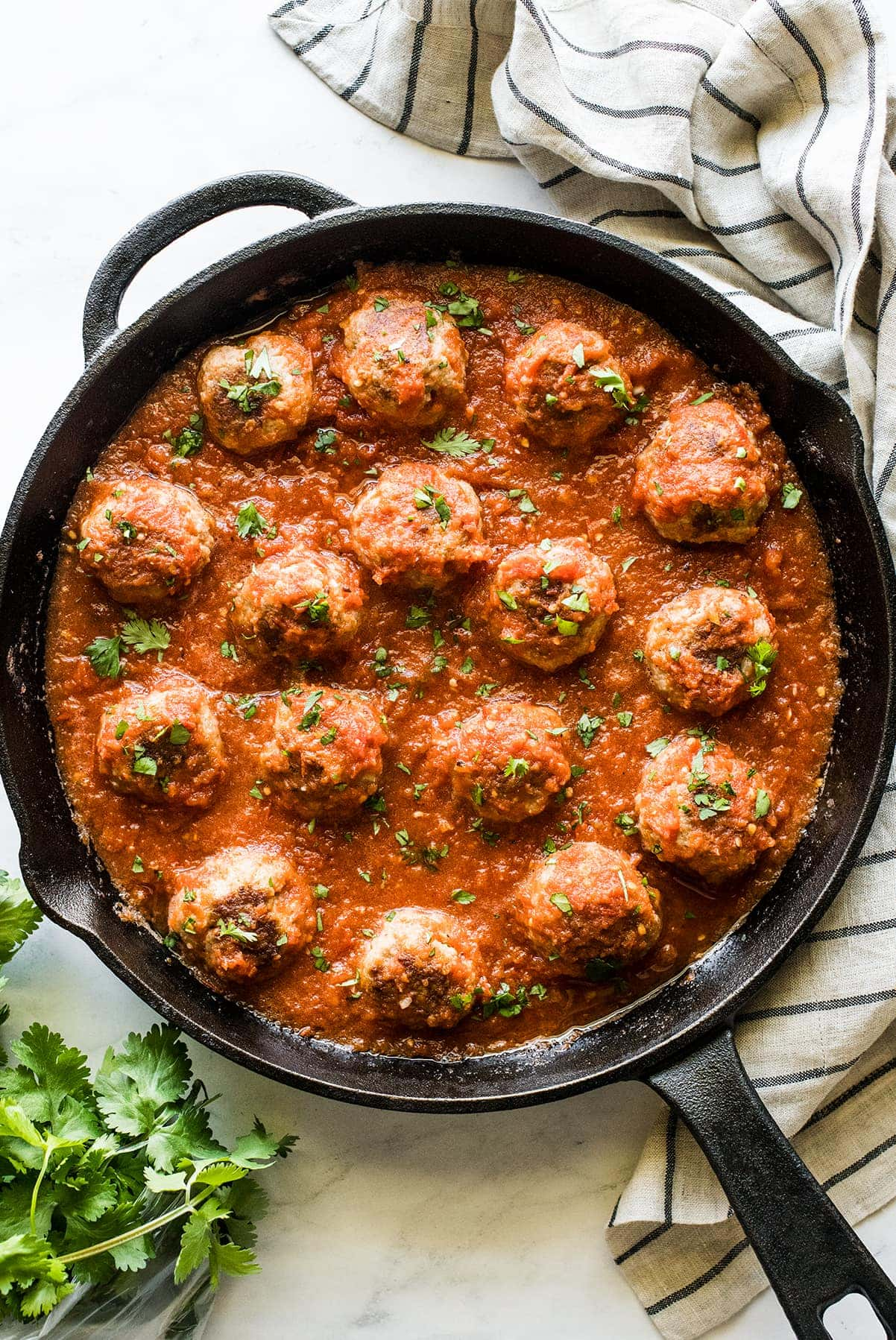 Mexican meatballs in a skillet with chipotle tomato sauce.