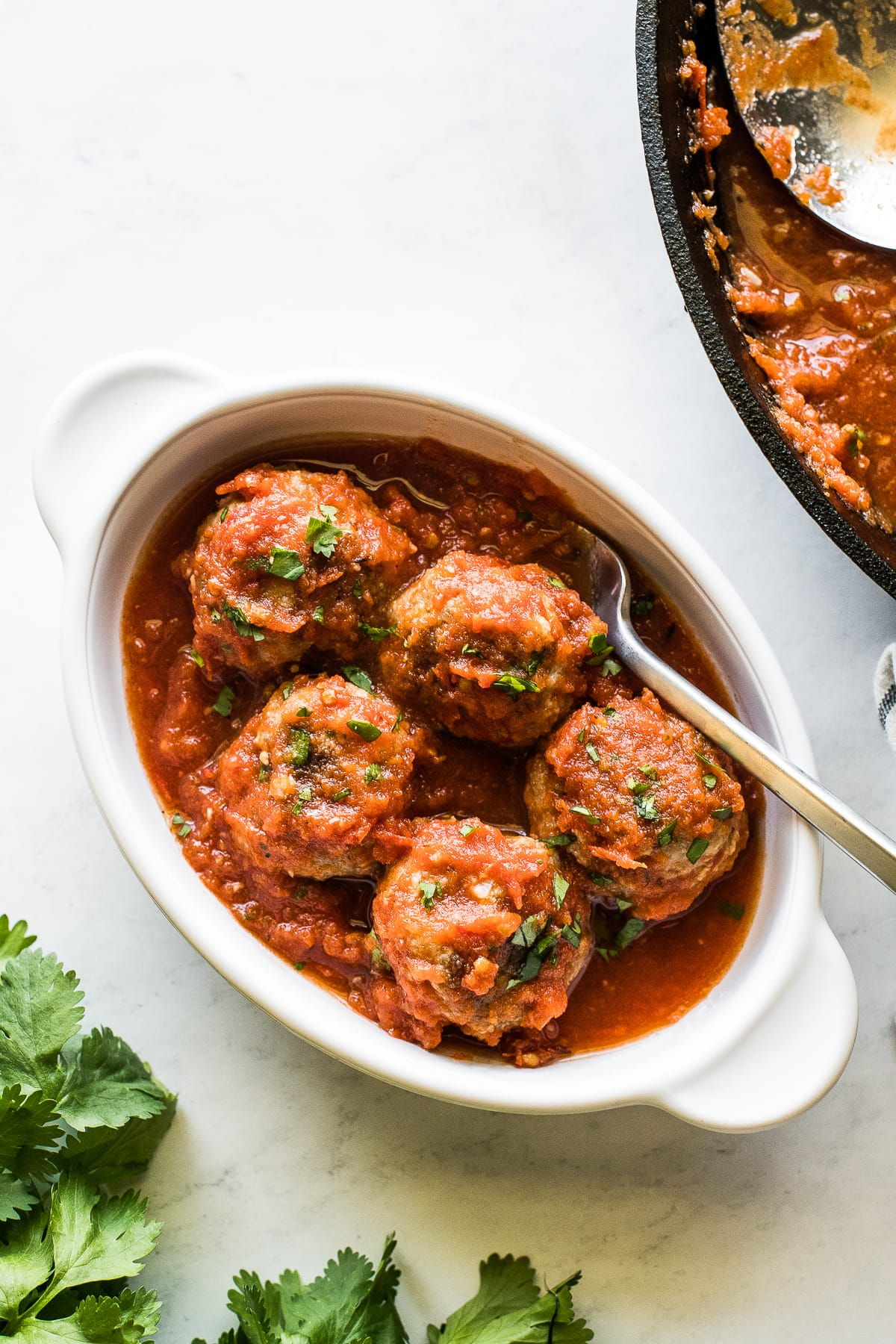 Mexican meatballs in a bowl with a fork.