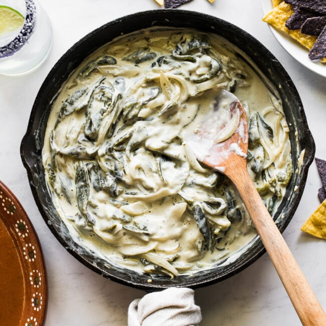 Rajas con crema in a skillet ready to be eaten.