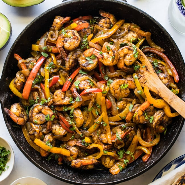Shrimp fajitas in a skillet.