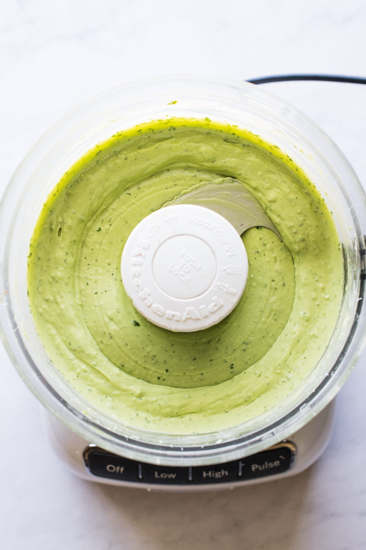 Avocado crema blended up in a food processor.