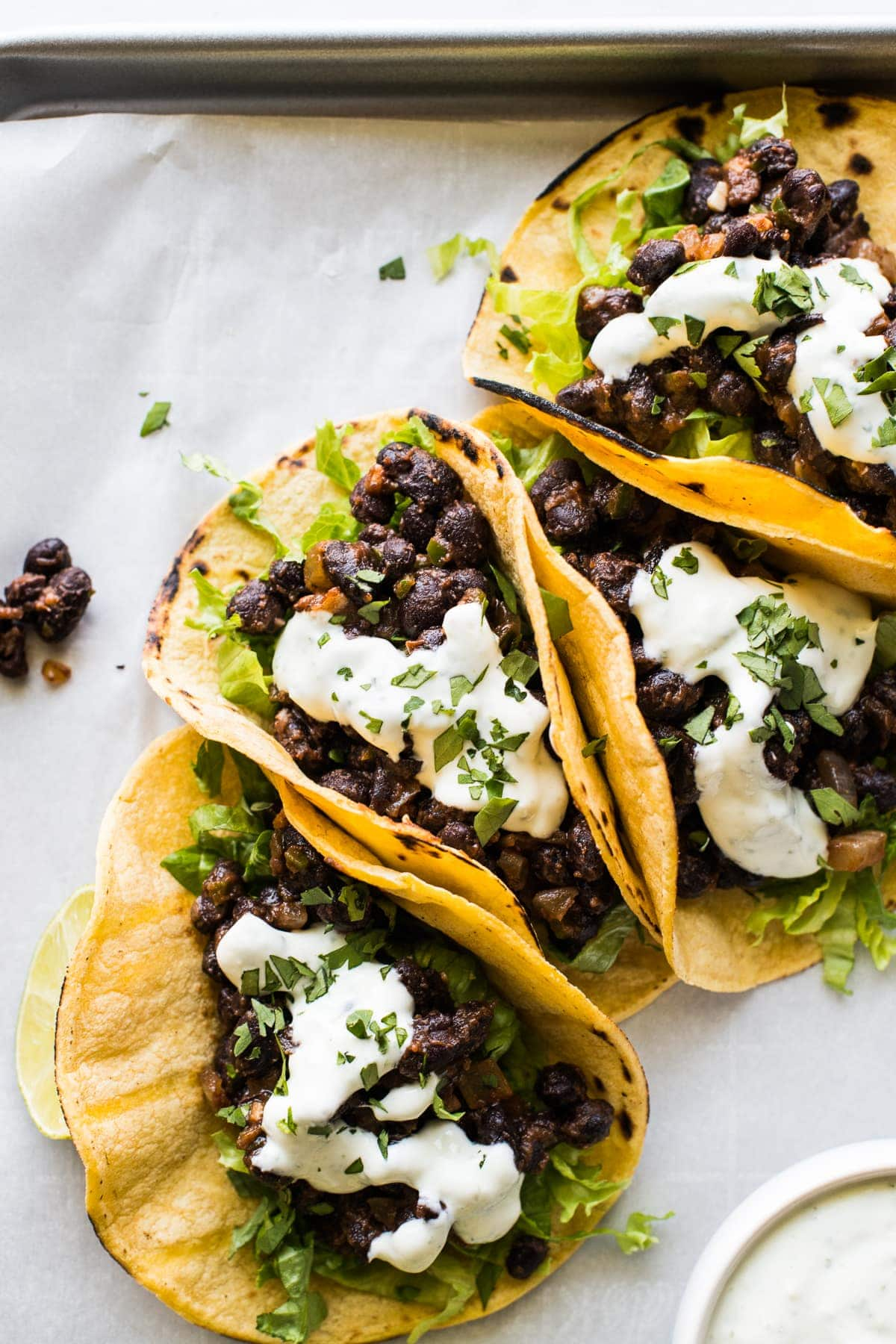 Black Bean Tacos topped with crema and chopped cilantro.