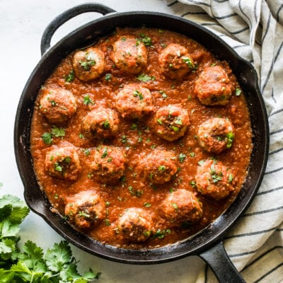 Mexican meatballs made from pork in a cast iron skillet.