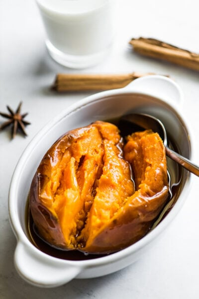 A cooked camote (or a Mexican candied sweet potato) in a bowl with piloncillo syrup.