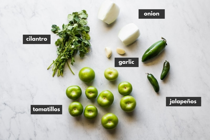 Ingredients for salsa verde on a table.