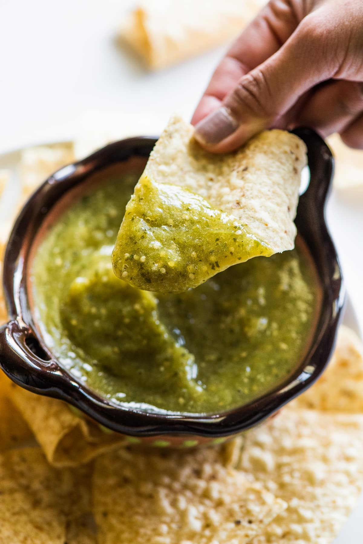 Salsa verde on a tortilla chip.