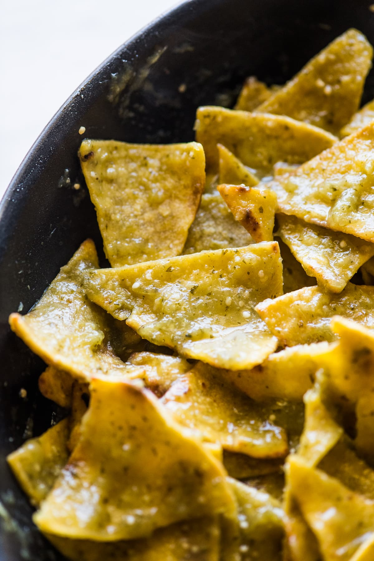 Chilaquiles verdes in a skillet.