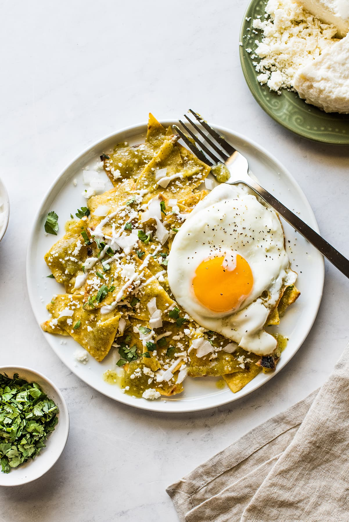 Chilaquiles Verdes topped with a sunny side up egg.