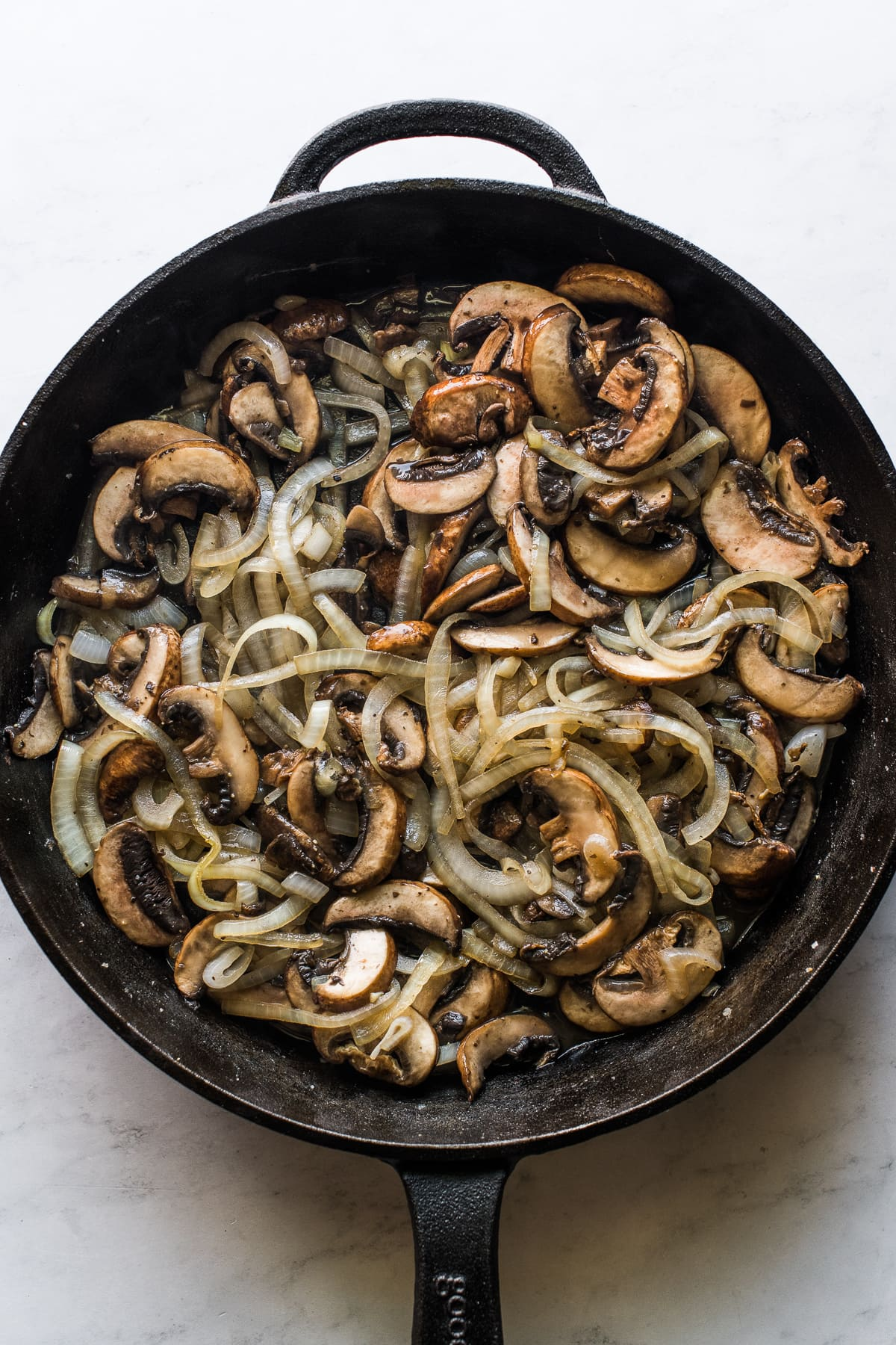 Sauteed onions and mushrooms for green bean casserole.