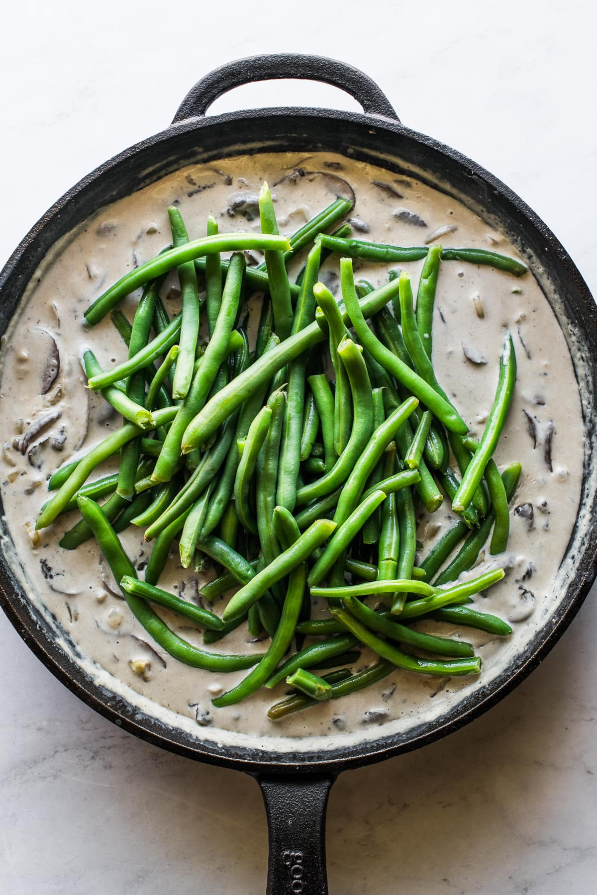 Fresh green beans in a gravy cream sauce for green bean casserole.