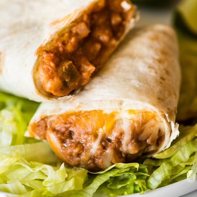 A bean and cheese burrito with melted cheese and refried beans.