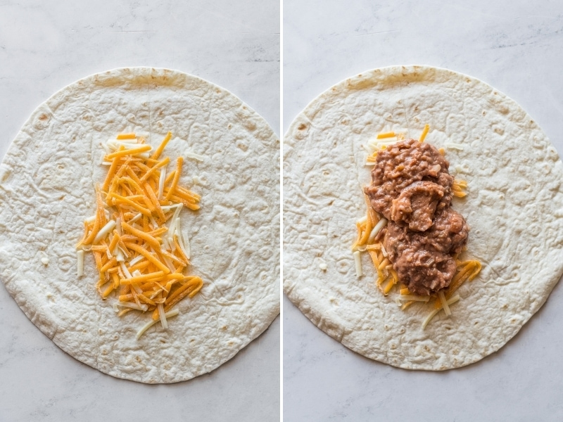 A flour tortilla topped with shredded cheese and refried beans.