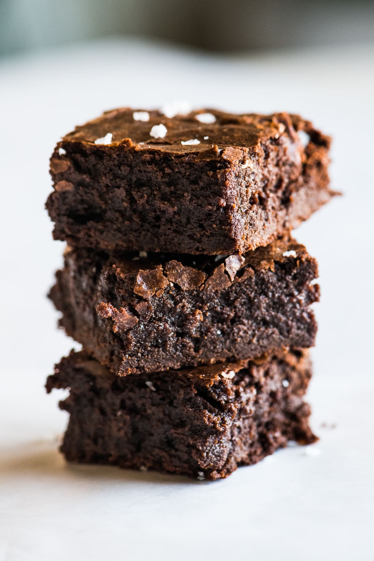Three fudgy Mexican brownies stacked on top of one another.