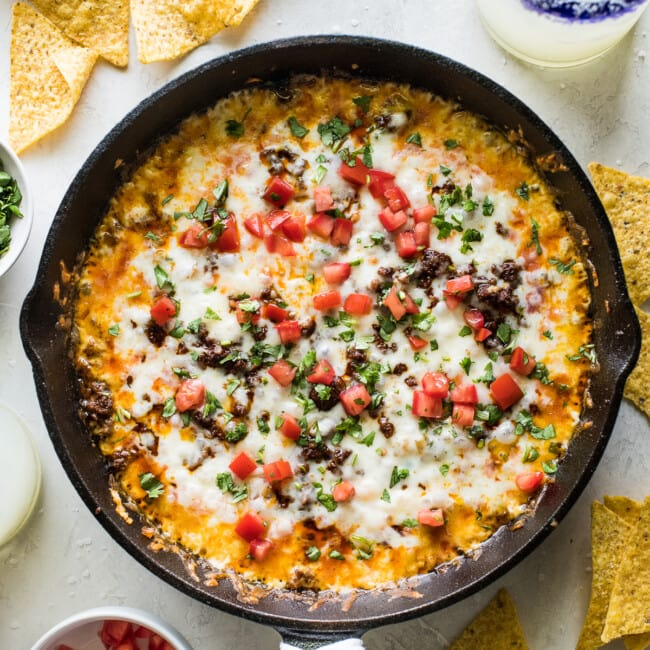Queso fundido in a skillet with crumbled chorizo.