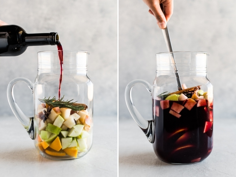 Winter sangria in a pitcher being mixed together.