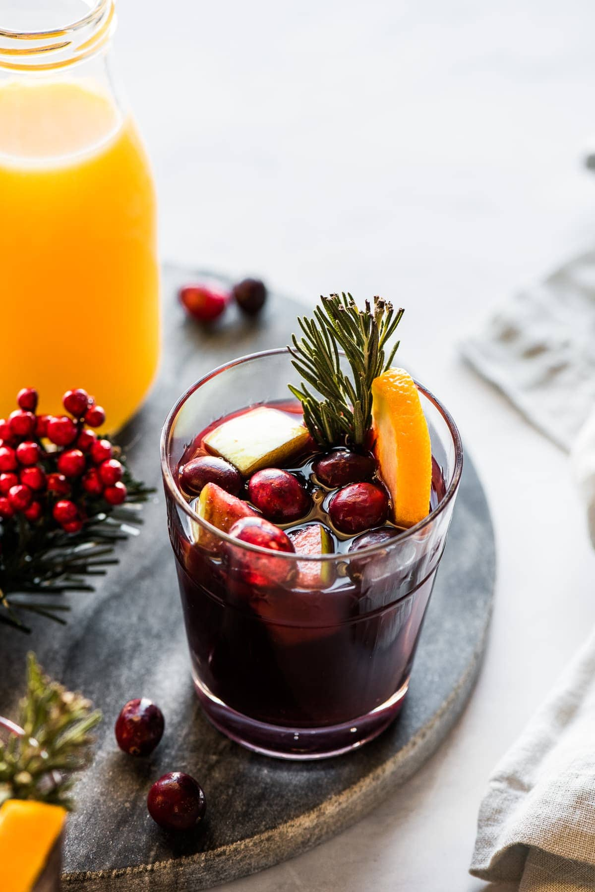 A cup of winter sangria made with red wine, fruit, and spices.