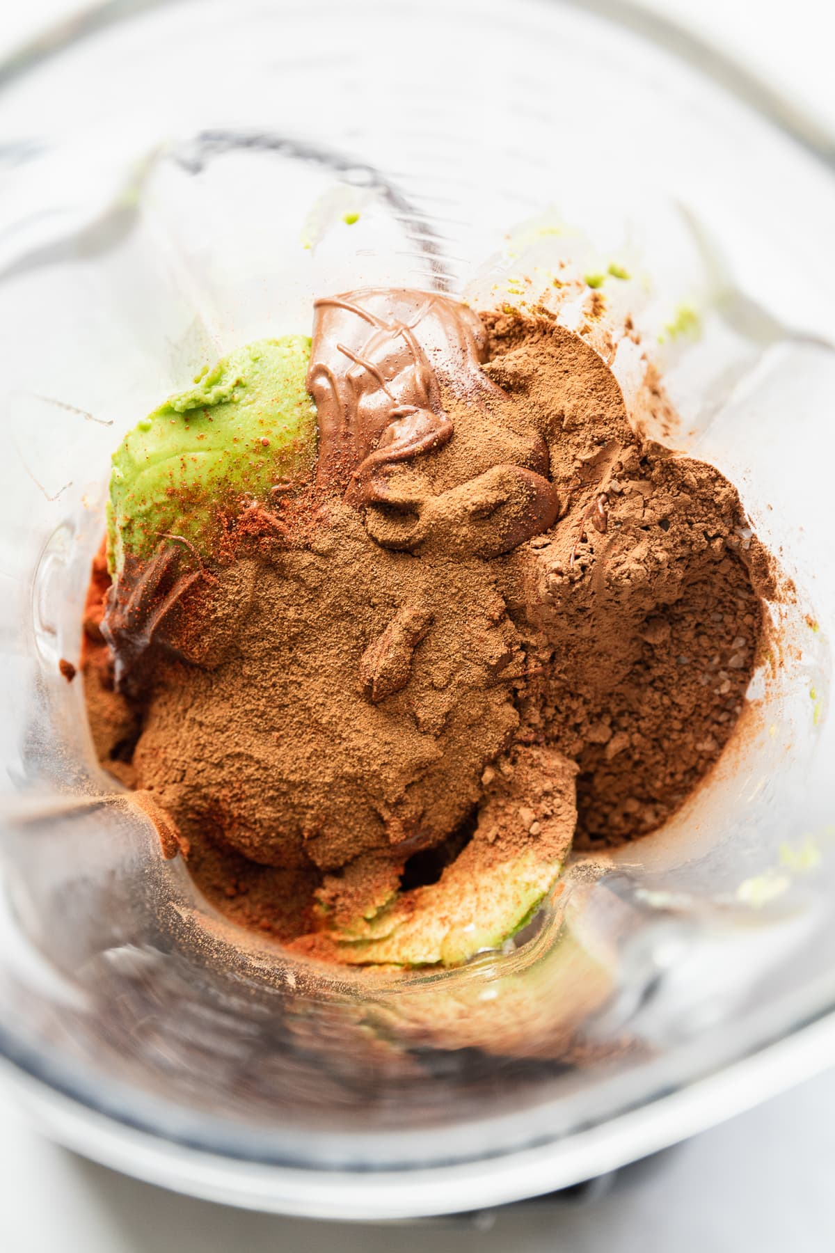 Ingredients for Avocado Chocolate Mousse in a blender.