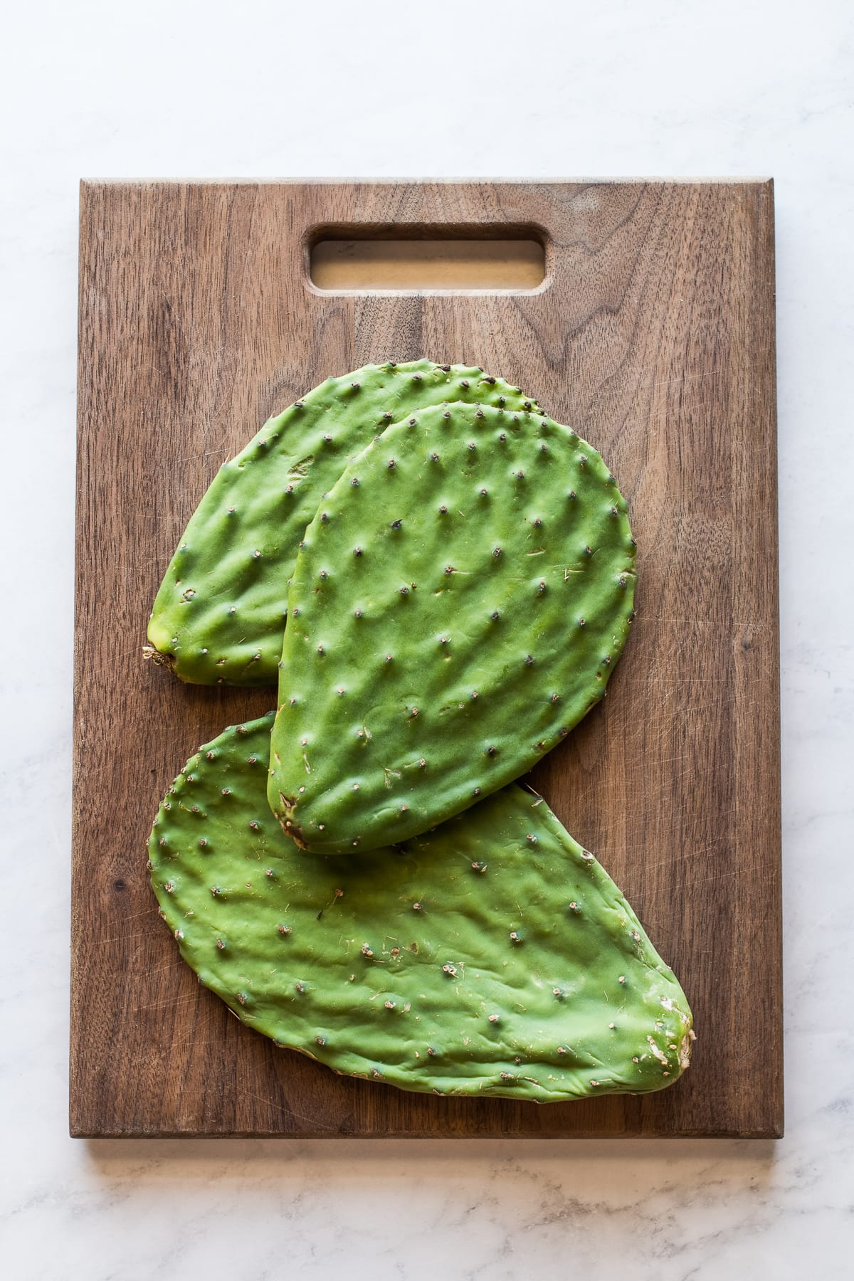 Nopales (cactus paddles) on a cutting board