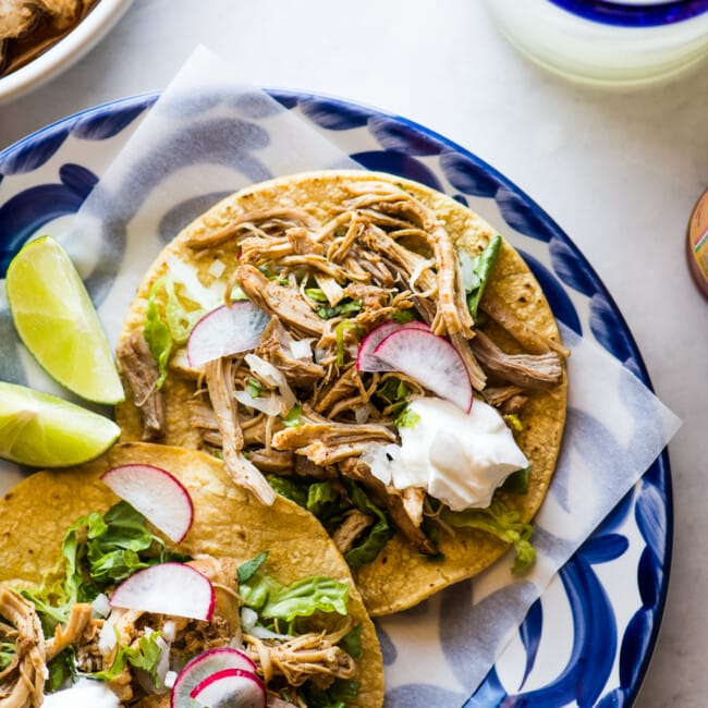 Instant Pot Chicken Tacos on a plate ready to be served.