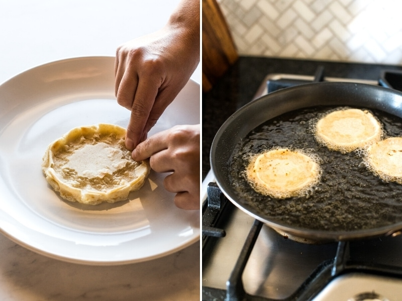 A hand forming sopes and then frying them in a skillet.