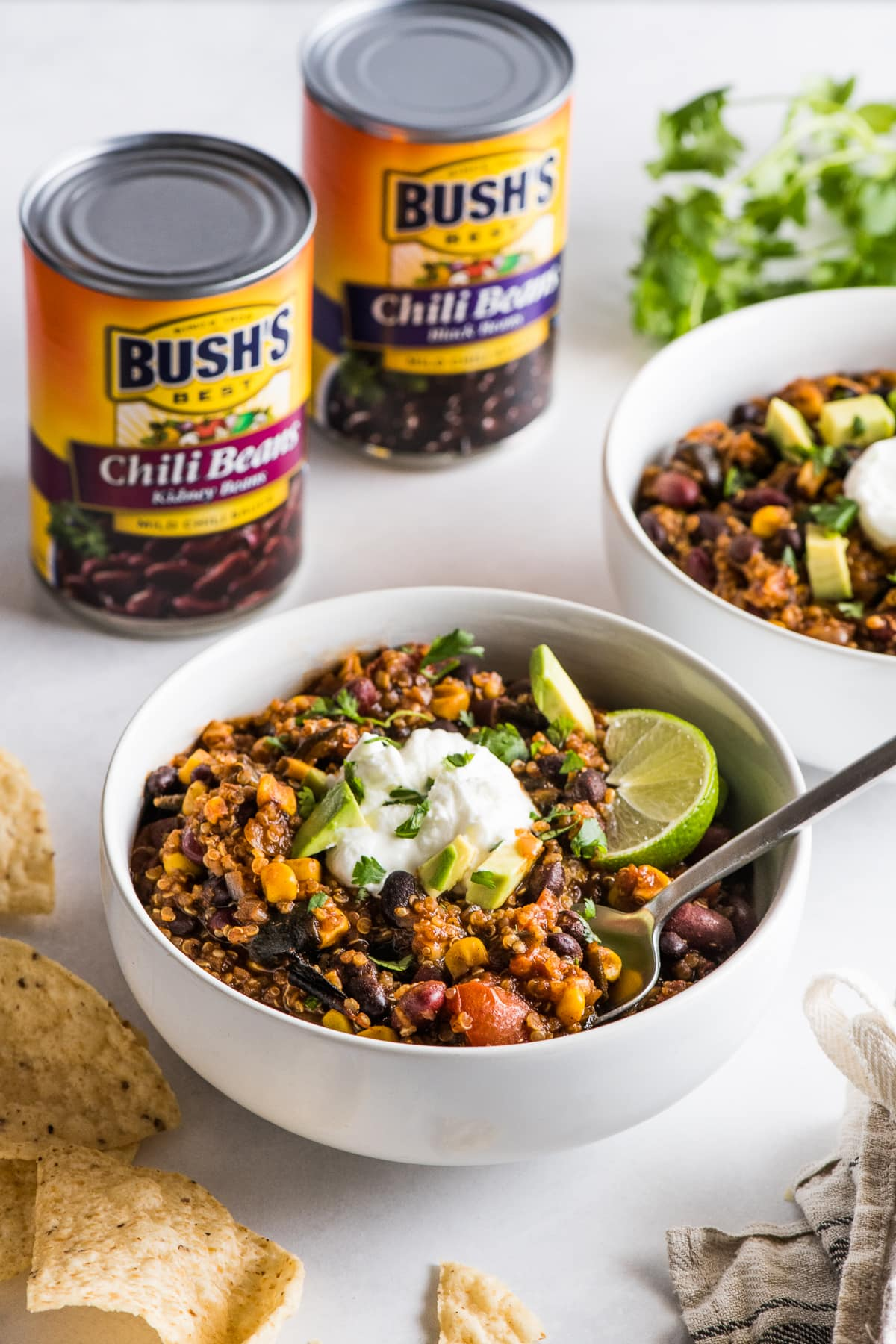 A bowl of quinoa black bean chili next to some tortilla chips.