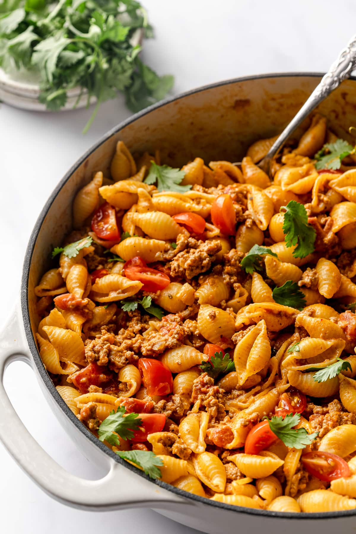 Easy taco pasta in a skillet ready to be eaten.