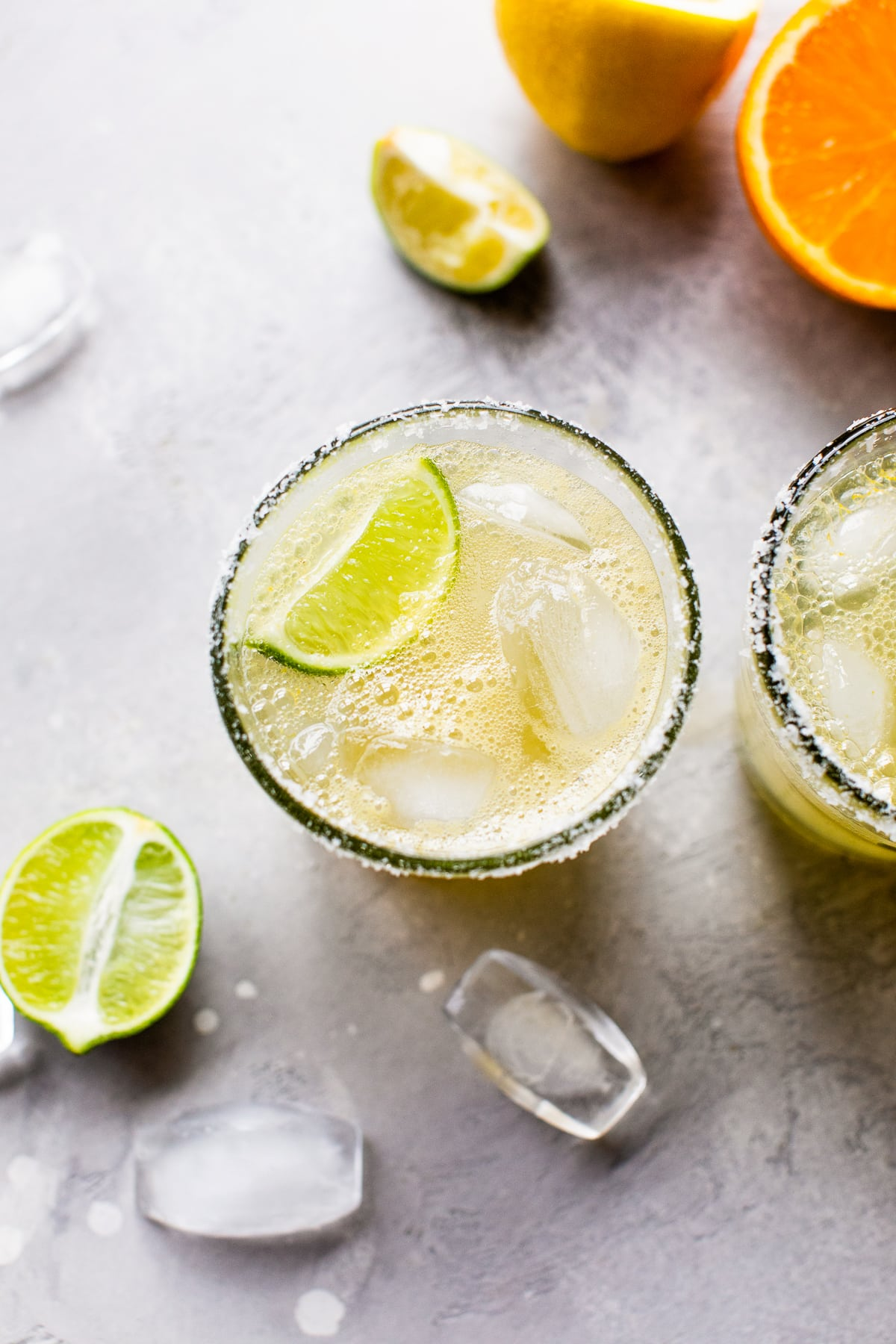 Virgin margarita mocktail on the rocks with a lime wedge.