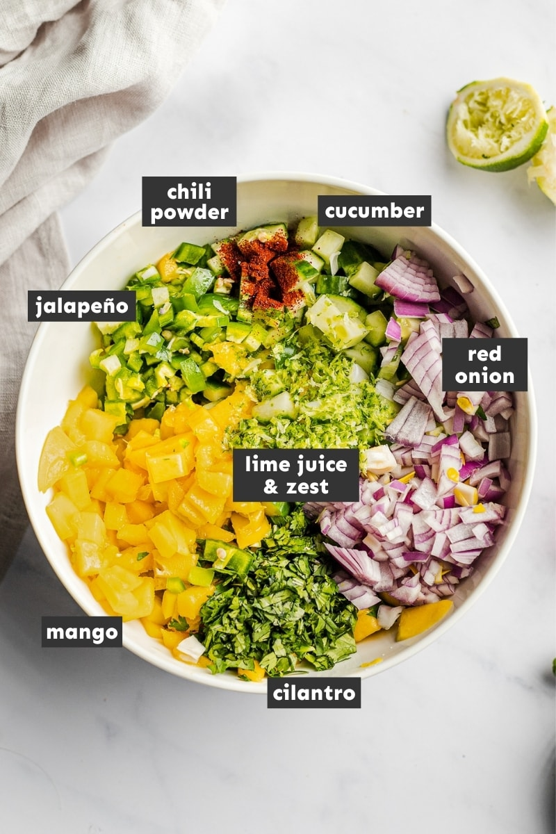 Ingredients for mango salsa in a large mixing bowl.