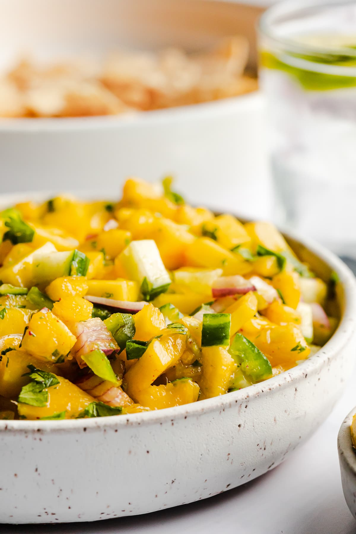 Mango salsa topped with chopped cilantro ready to be served.