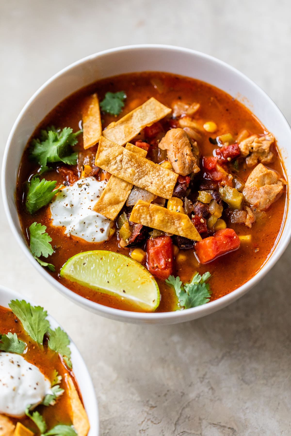 Healthy and delicious Southwest Chicken Soup topped with tortilla strips.