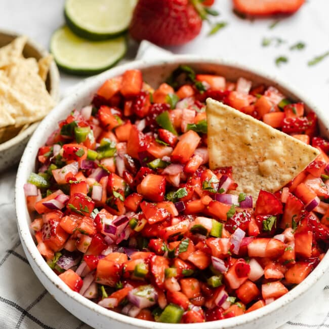 Strawberry Salsa in a bowl next to tortilla chips.