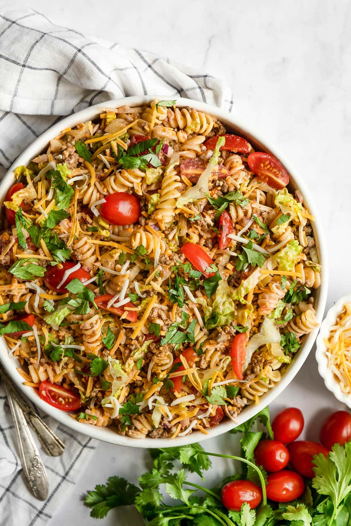 Taco pasta salad in a bowl topped with cilantro.