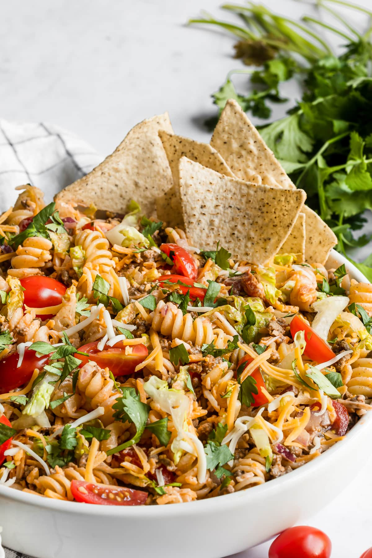 Taco pasta salad served with tortilla chips
