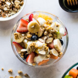 A bionico Mexican fruit bowl topped with honey and granola.