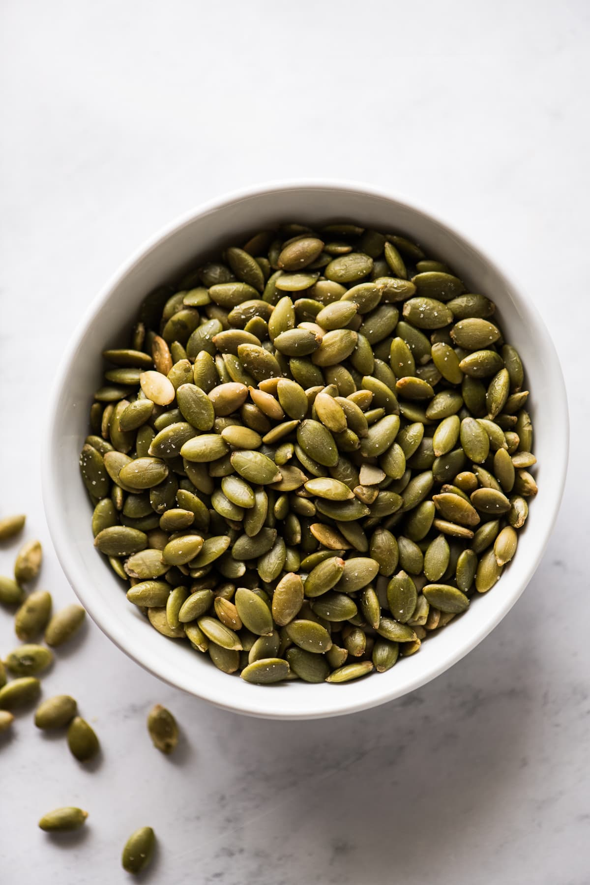 Pepitas (roasted pumpkin seeds) in a small bowl.