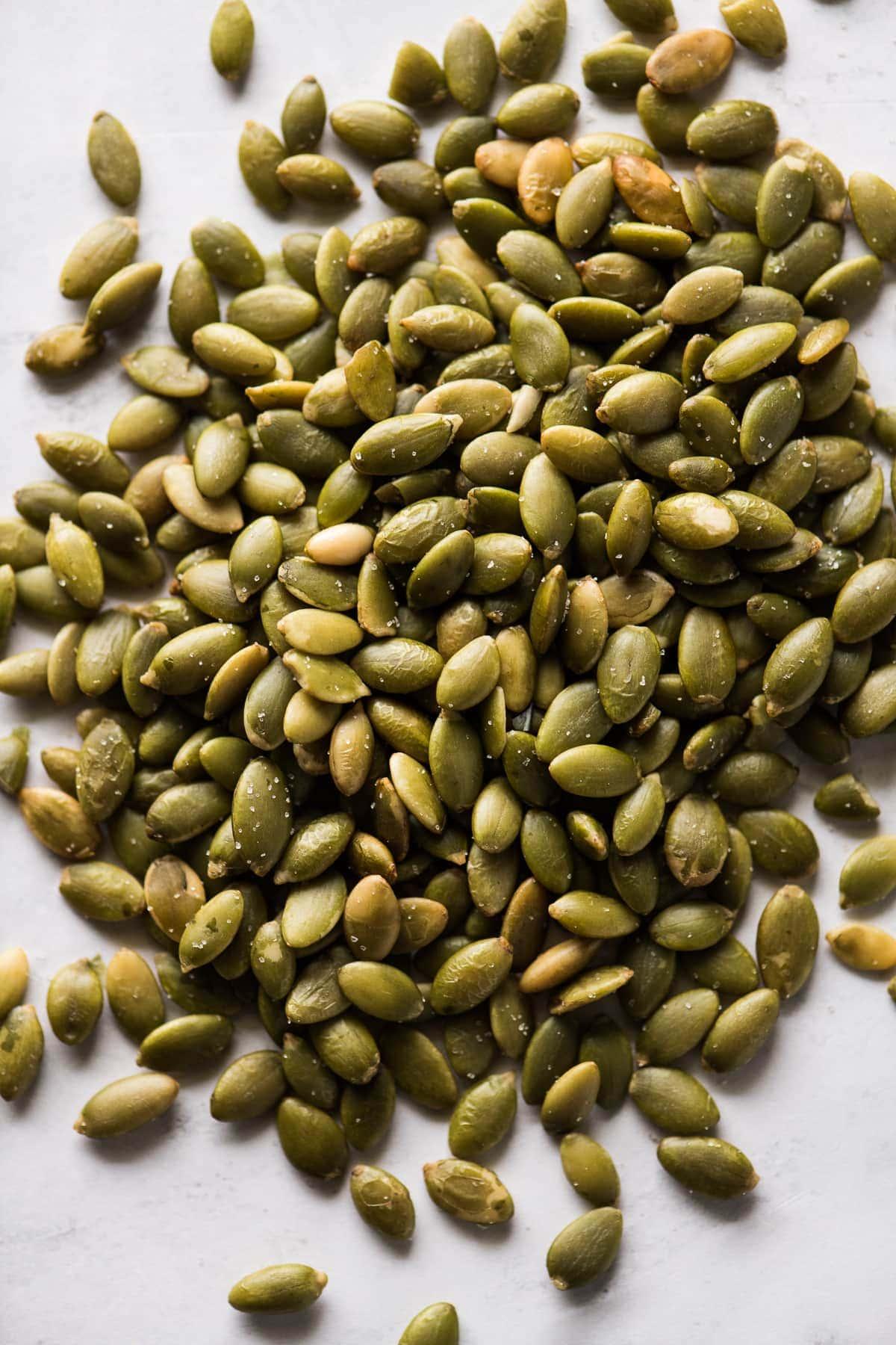 Pepitas (roasted pumpkin seeds) on a table.