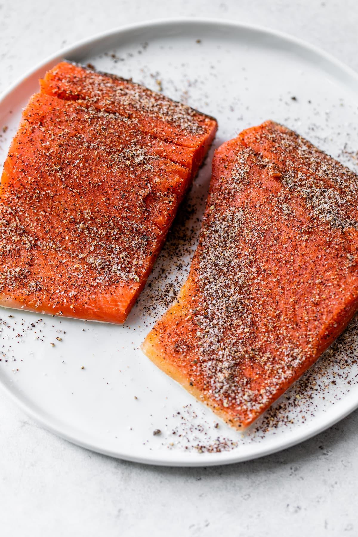 Salmon filets seasoned with a dry rub.